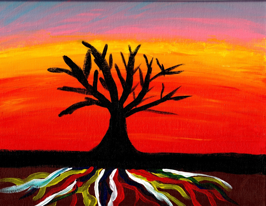 Bare black tree in the sunset with brightly colored roots